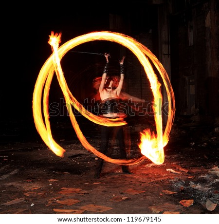 Woman holds in his hand the fire - stock photo