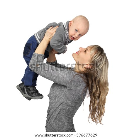Woman holds infant baby on hands isolated on white background in square - Mother plays with little son, childcare and motherhood - stock photo