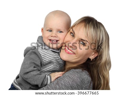 Woman holds infant baby on hands isolated on white background - Mother and little son, childcare and motherhood - stock photo