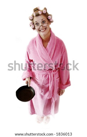 Woman holds out a cast-iron frying pan - stock photo