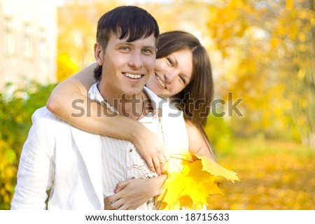 woman hug man in autumn park - stock photo