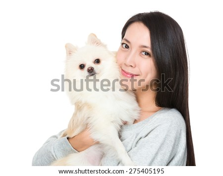 Woman hug with her domestic pet - stock photo