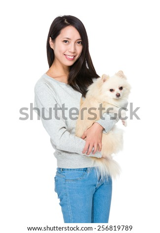Woman hug with her lovely dog - stock photo