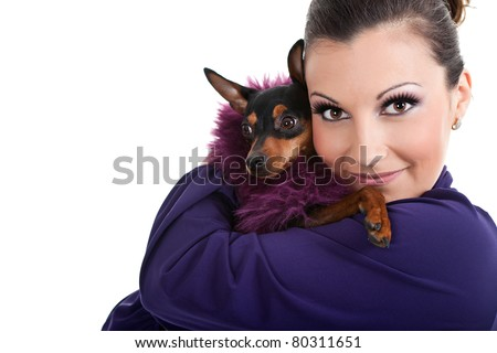 woman  hugging fashion little dog, miniature pincher  isolated on white background - stock photo
