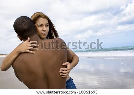 Woman hugging her boyfriend - stock photo