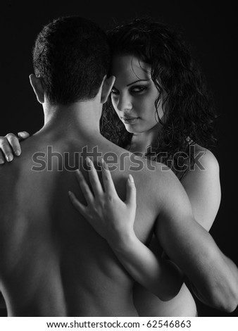 woman hugging man isolated on black background