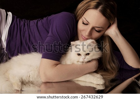 Woman hugging white cat - stock photo
