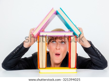woman idea of building a house - stock photo