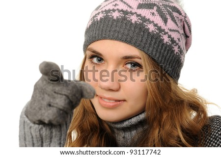 woman iin a cap pointing at you, isolated on white background - stock photo