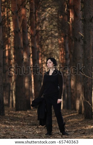 woman in a beautiful spring forest - stock photo