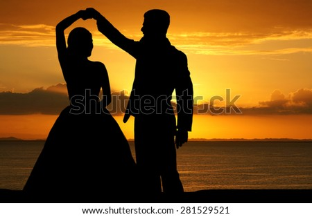 Woman in a beautiful wedding dress with groom - stock photo