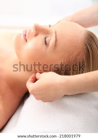 Woman in a beauty salon .Beauty salon, the woman at face massage . Attractive blonde woman in spa salon