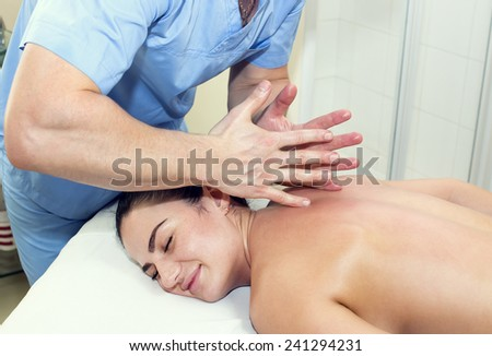 Woman in a beauty salon doing massage - stock photo