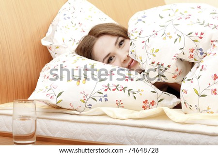 Woman in a bed before or after sleep - stock photo