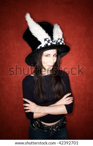 Woman in a big hat with rabbit ears - stock photo