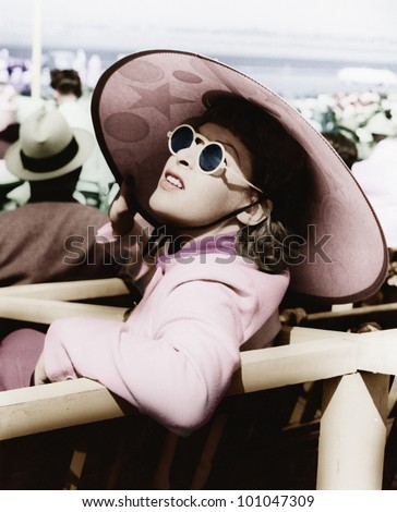 Woman in a big sun hat and sun glasses - stock photo