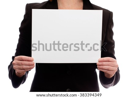 Woman in a black suit holding a blank piece of paper.