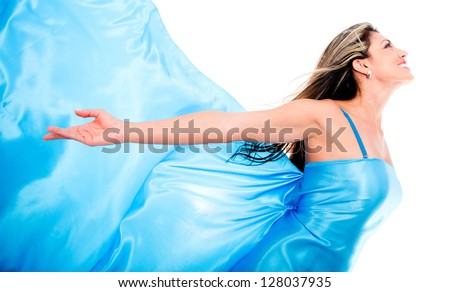 Woman in a blue dress feeling the wind - isolated over a white background - stock photo