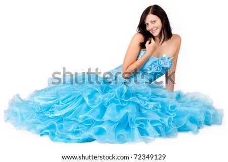 woman in a blue dress posing on a white background - stock photo