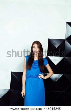 Woman in a  blue elegant dress