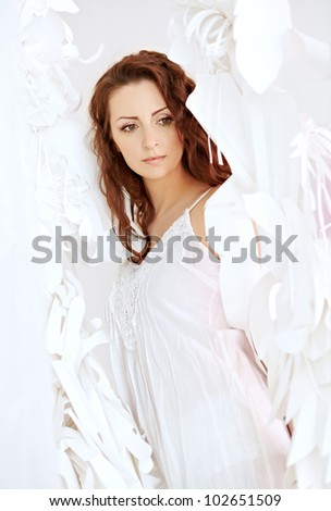 Woman in a bright  room. Angel - stock photo
