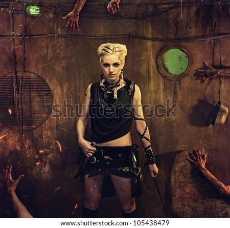 Woman in a bunker with zombie hands around her - stock photo