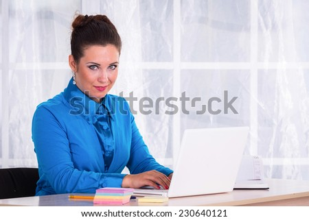 Woman in a business suit. Business woman sitting at the table, working with the computer. Business, work, business woman - business concept girl. The idea about the woman's business. - stock photo