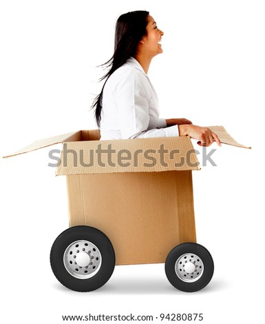Woman in a car made of cardboard box - fast shipping concepts - stock photo