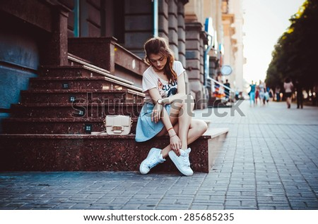 Woman in a city - stock photo