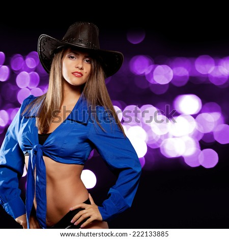 Woman in a cowboy hat. On bright light purple background.