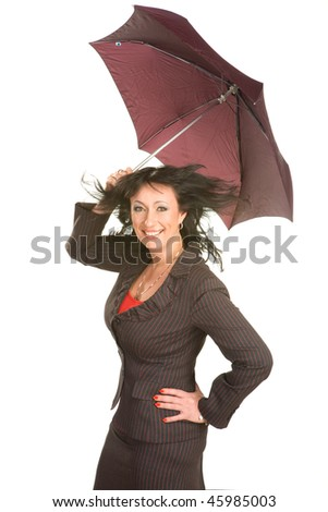 Woman in a dark suit with umbrella poses on a white background - stock photo