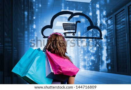 Woman in a data center holding shopping bags and looking at a drawing with a shopping cart into a cloud - stock photo