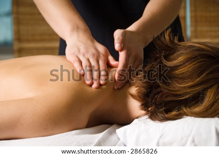 woman in a day spa getting a neck massage - stock photo