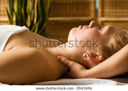 woman in a day spa getting a neck massage by therapist - stock photo