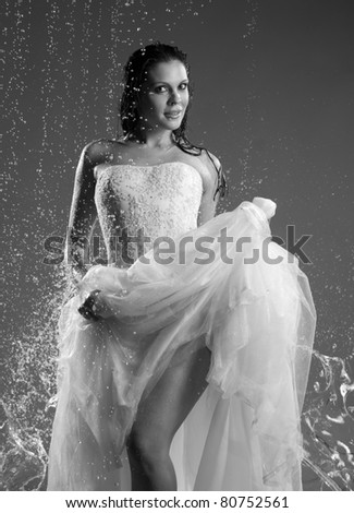 woman in a dress the bride on the water jets; monochrome