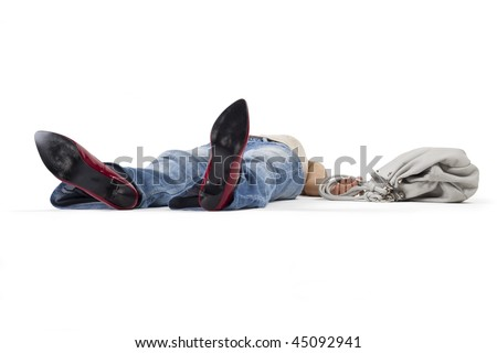 Woman in a faint lying on the floor holding a bag. - stock photo