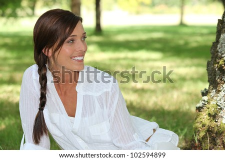Woman in a field - stock photo