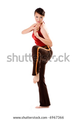 woman in a fighting crane pose in a fitness session - stock photo