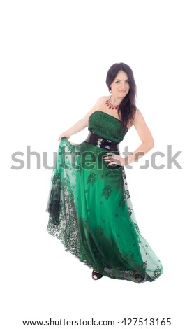 woman in a green dress on a white background - stock photo