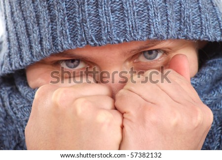 Woman in a hood hiding her face with fists - stock photo