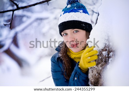 woman in a jacket in the winter in a forest