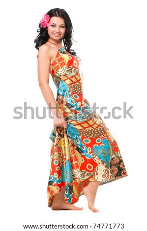 woman in a long, bright summer dress in full length on a white background - stock photo