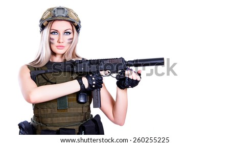 Woman in a military camouflage holding the smg isolated over white background - stock photo