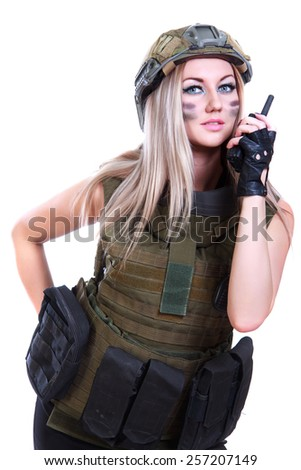 Woman in a military camouflage with a radio isolated over white background - stock photo
