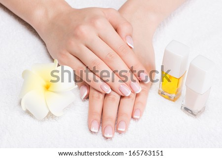 Woman in a nail salon receiving manicure by a beautician. Beauty treatment concept. - stock photo