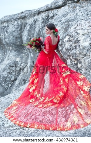 Woman in a red dress. Bride. Indian bride