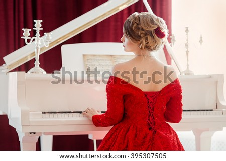 Woman in a red evening dress - stock photo