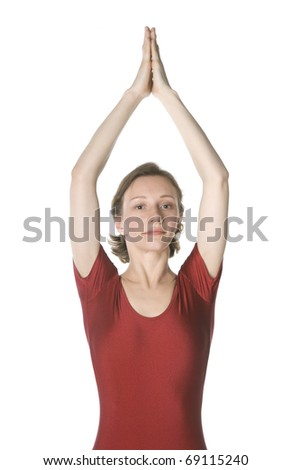 Woman in a red leotard exercising over white background