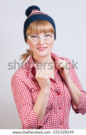 woman in a red plaid shirt and a cap - stock photo