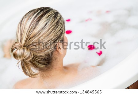 Woman in a spa taking a foam bath - stock photo